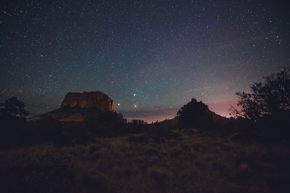 Looking south towards Courthouse Butte (left) and Bell Rock (right). The three bright points to the right of Courthouse Butte are actually Saturn, Mars, and the star Antares