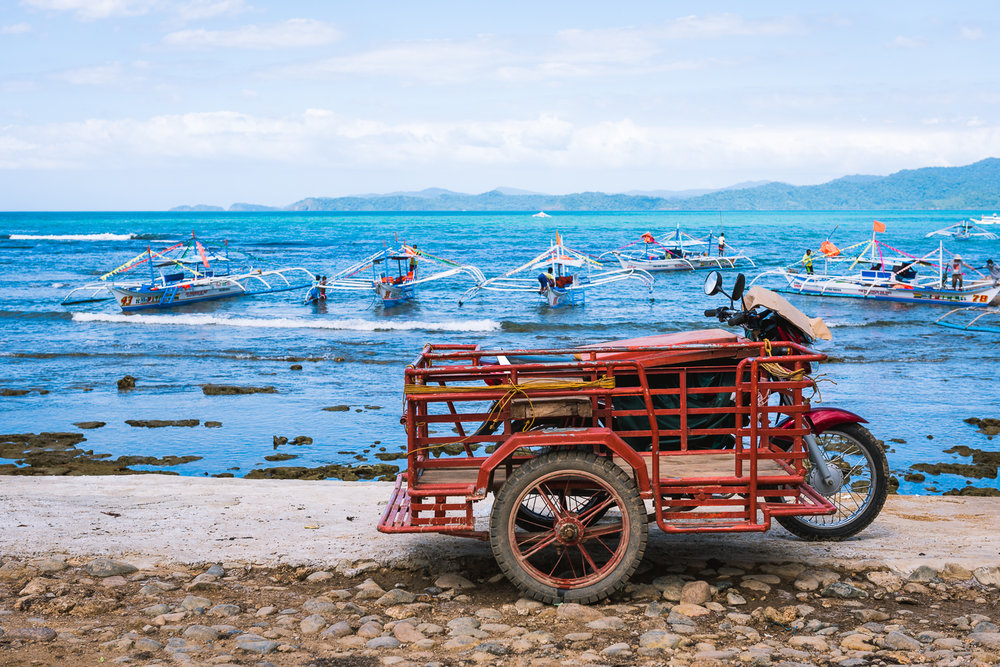 When visiting Philippines, we usually make time to escape the crowds and chaos of Manila by visiting other places within the Philippine islands. This year, we visited the island of Palawan. This shot was taken at the small port town of Sabang while waiting for our ferry to the underground river. This is one of my favorite shots from Palawan because it shows the beauty and blueness of Palawan waters, while showcasing a staple of Filipino transportation, the tricycle.