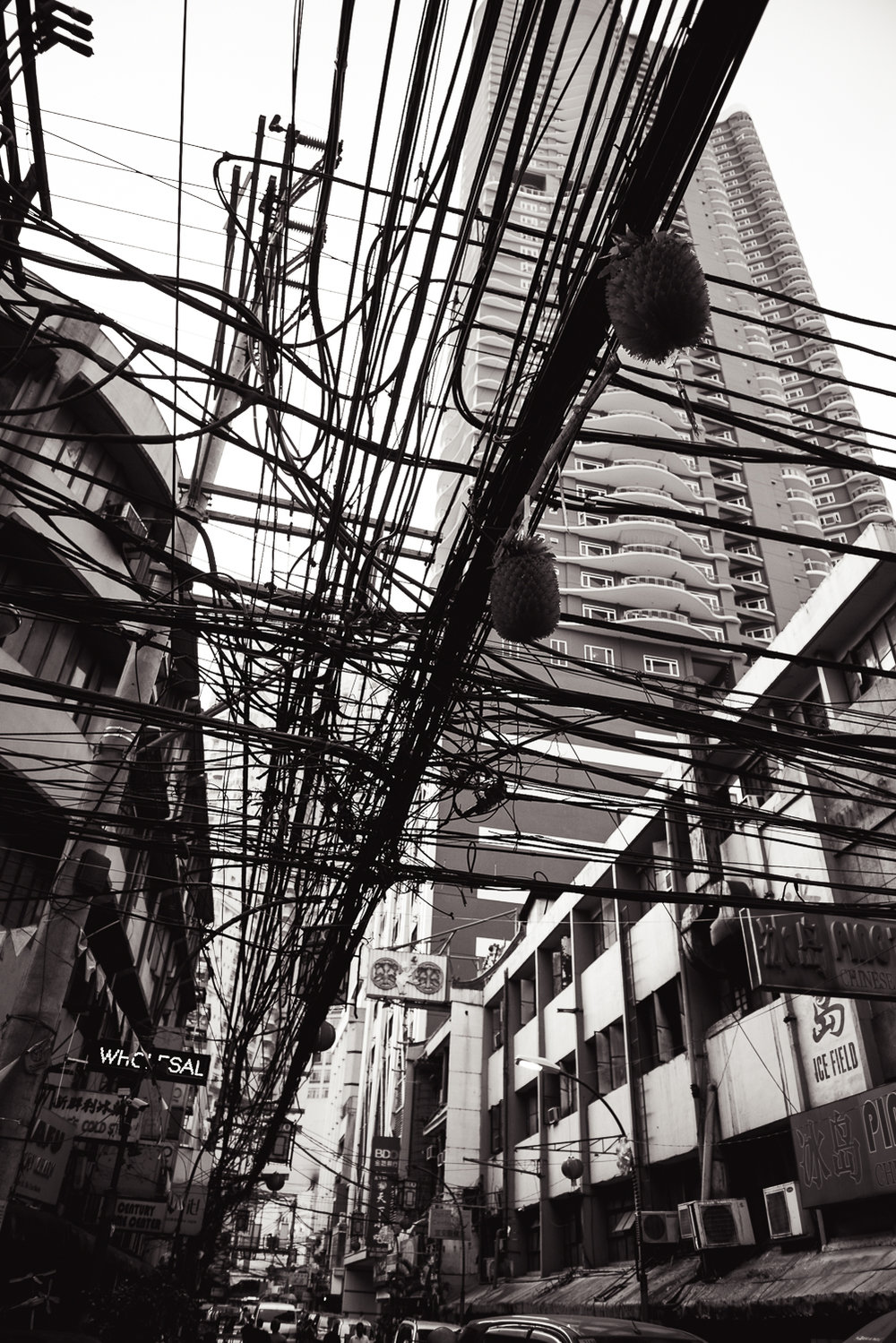 During one of the last days in the Philippines, we visited the Chinatown section of Manila. Like most of the Metro Manila region, Chinatown was extremely crowded and chaotic. The infrastructure was no different. Walking through Chinatown, one of the things I noticed when looking past the many fruit stands, bakeries, and Chinese restaurants was this mangle array of power lines. Just like the Philippines itself, this section of wires was crowded, chaotic, and unorganized, yet somehow still manages to get the job done.