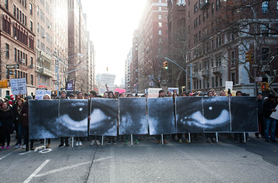 (December 13th 2015)  50,000 strong march down NYC streets protesting against the failure to indict cop Daneil Pantaleo. Participants in the Millions March hold signs representing those who have died due to police violence.