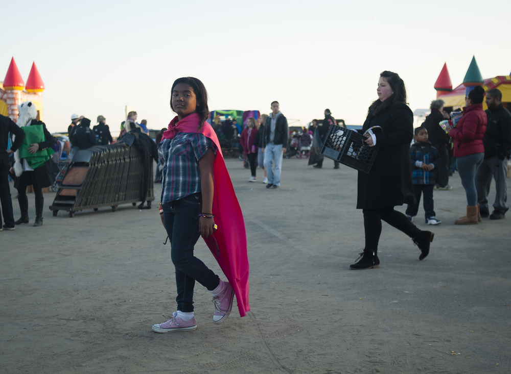 (November 17 2012) Three weeks after Hurricane Sandy, grassroots organizations held a carnival for the children of Far Rockaway, giving them a break from the wreckage and destruction that surrounded them. As the sun sets, many of them leave the cheerful event only to return to their homes that were still without power. (3 of 3)