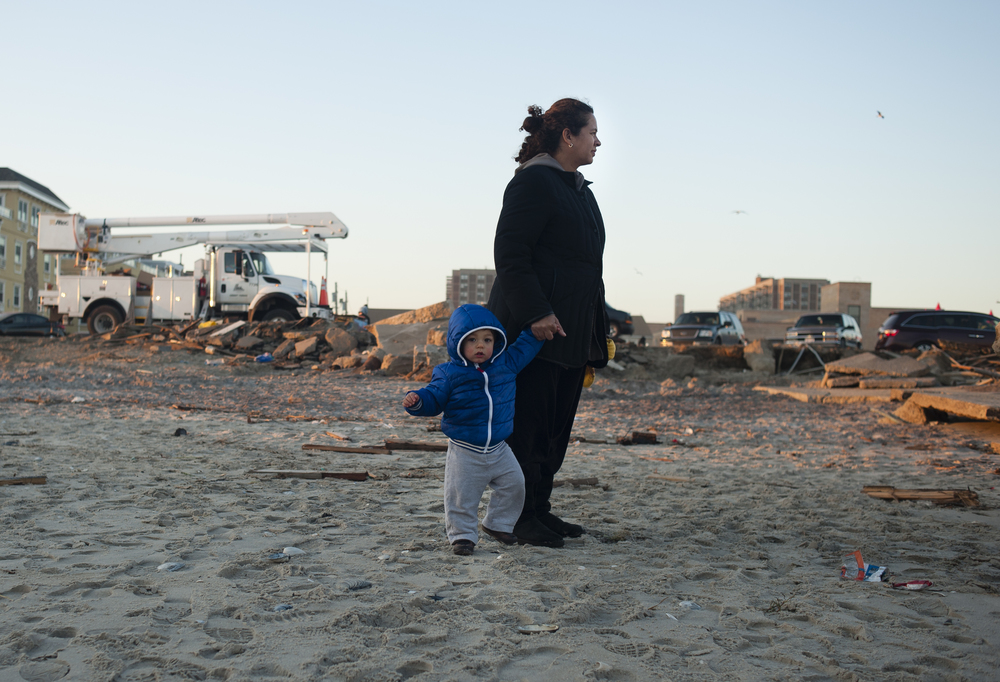 (November 17th 2012)Three weeks after Hurricane Sandy, grassroots organizations held a carnival for the children of Far Rockaway, giving them a break from the wreckage and destruction that surrounded them. As the sun sets, many of them leave the cheerful event only to return to their homes that were still without power. (1 of 3)