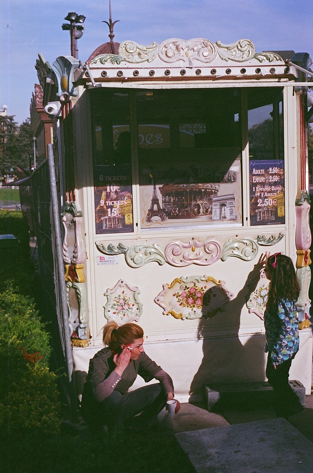 (October 29th 2014) Mother and daughter rest behind a crepe stand before finishing the day touring Paris, France.