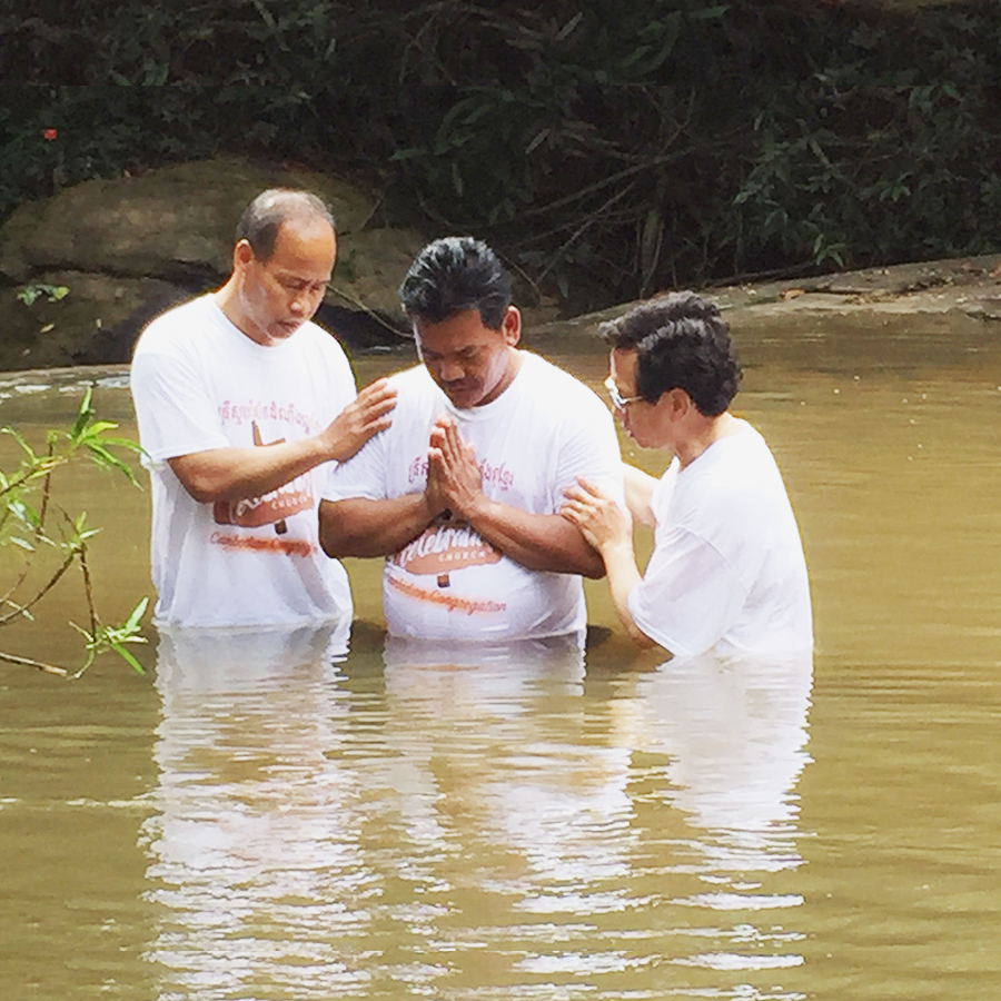 Pastor Sonly Goy baptizing a Two Star General who is currently being trained to lead our new church plant in Cambodia on a military base.