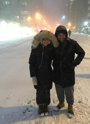 Just two friends out in a blizzard wearing onesies under their parkas. FYI we will be re-creating this photo.
