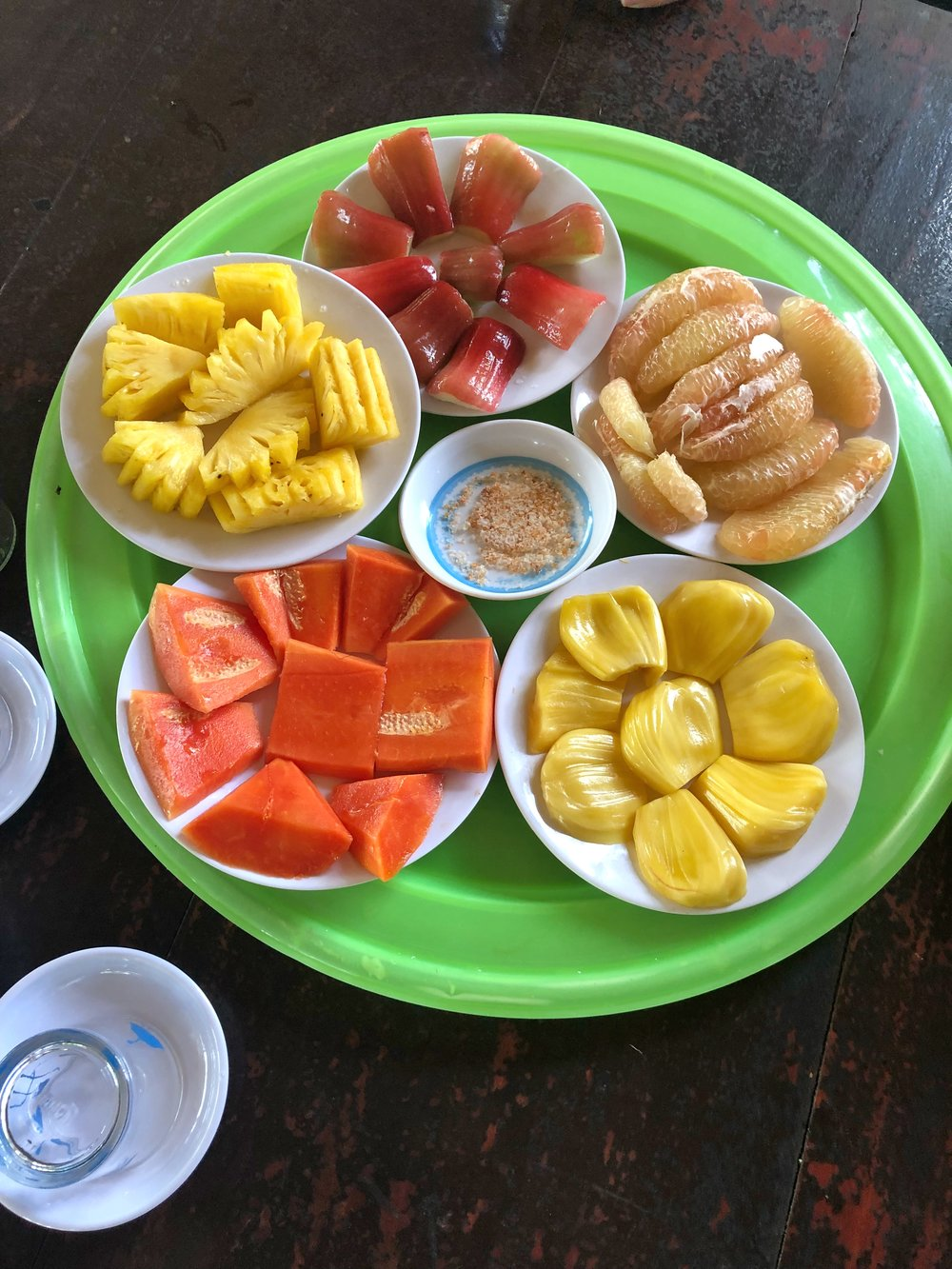 From the top counter clockwise: Java Apple, Pomelo, Jackfruit, Papaya, and Pineapple