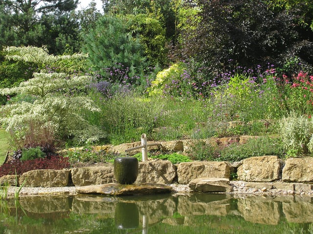 After a visit to Japan, my clients in this Winchcombe garden requested a Japanese water feature.