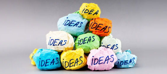 "Photo of a stack of crumpled up balls of different colored paper, each ball labeled ""IDEA"""