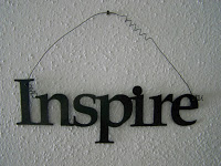 "Wall-hanging of the word ""Inspire"""
