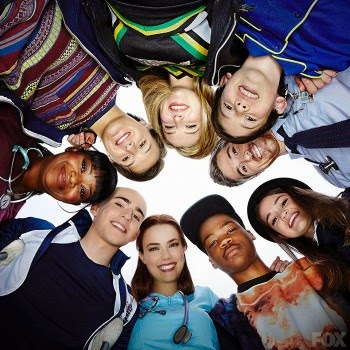 Characters from Red Band Society posed in a circle, looking down.