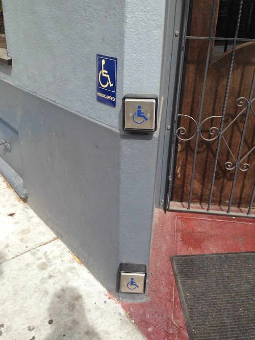 Business entrance has two accessible buttons to auto-open the door, depending on if you're standing or sitting, wheelchair user, walker or came user, prefer to use your hands or kick the button