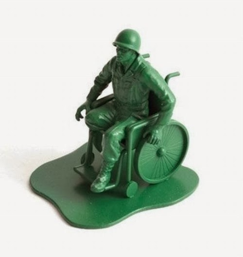 Green plastic army man in wheelchair