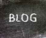 "The word ""BLOG"" written in white chalk on a gray slate blackboard"