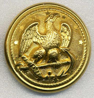 Photo of a Civil War era Union Army button, brass colored, with engraving of an eagle