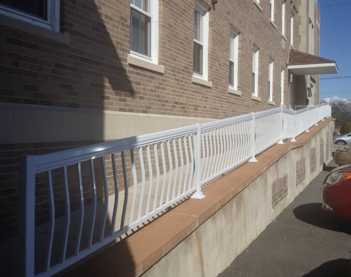long ramp to side entrance of an apartment building