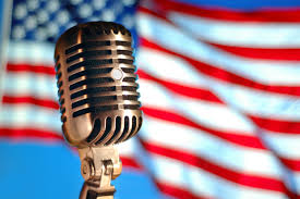 Old-fashioned microphone with American flag behind