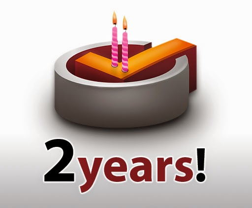 "3-D illustration of a cake with 2 candles, with ""2 years!"" printed underneath"