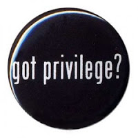 "Illustration of a black button with ""got privilege?"" in white letters"