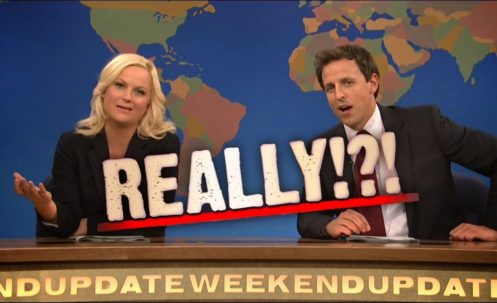"Photo of Amy Pohler and Seth Meyers on the Weekend Update set, with the word ""REALLY!?!"" superimposed"