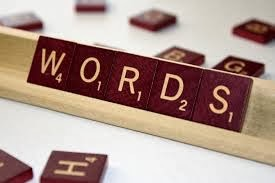 "Picture of Scrabble tiles on a rack, spelling ""WORDS"""