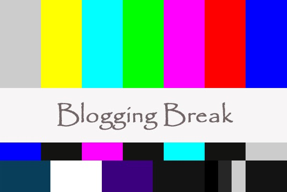 Blogging Break sign with old-style rainbow tv test pattern in the background