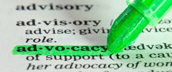 "Close up picture of a dictionary page with the word ""advocacy"" being highlighted in green with a highlighter pen"