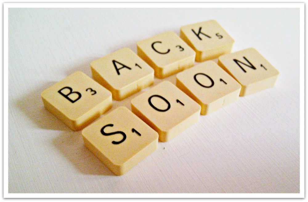 "Picture of Scrabble tiles spelling out ""Back Soon"""