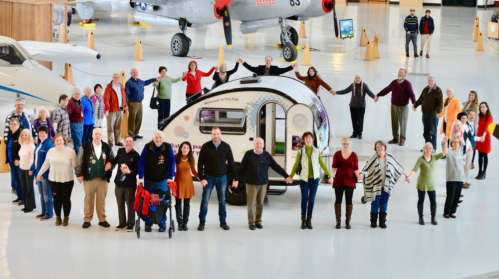 Rotarian Peacebuilders in District 5100 gather at The Hub Peacebuilder Tour Launch in McMinnville, Oregon beneath the wing of the Spruce Goose.