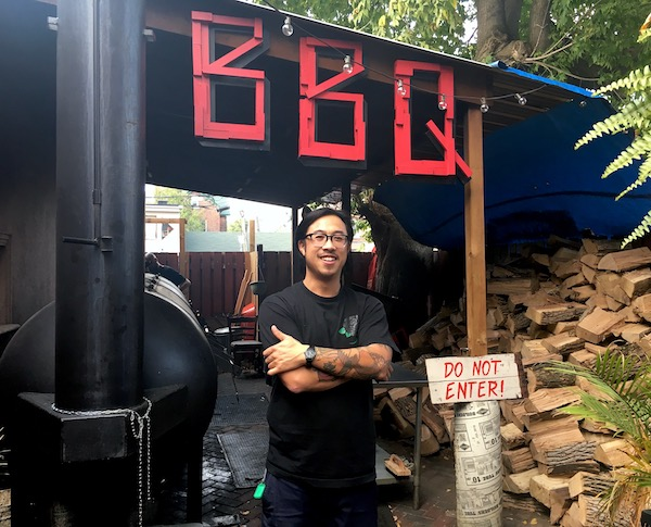 "Smoke Signals Bar-B-Q  celebrated its first anniversary on October 1st, but in fact, the building blocks have been in place for the last decade.   Owner/chef Nicholas Chen-Yin  made authentic central Texas barbecue in his backyard while working as a graphic and industrial designer full-time for 10 years before opening up his first restaurant.  It was only after a chance meeting with  chef Craig Wong  (  Patois   and   Jackpot Chicken Rice   in Toronto,   Ting Irie   in Dubai) that he decided to do it professionally.  Thank goodness, because it's one of the city's best spots for 'cue.  Here's 15 reasons why:  1)  In order to understand Chen-Yin's ""lifelong obsession"" and staunch commitment to Texas barbecue, you need to understand the pit masters that changed the game, specifically   Louie Mueller   (pronounced Miller) in Taylor, Texas and all his grandchildren that opened barbecue offshoots.  Two barbecue gods worked with the family before venturing out on their own:   Aaron Franklin  (  Franklin Barbecue  ) worked with  John Mueller  (one of Louie's grandsons), and   John Lewis   was the pitmaster at   la Barbecue   – owned by granddaughter  Leanne Mueller .  Chen-Yin learned from  Lance Kirkpatrick , the once longtime pitmaster at  Louie Mueller .  2)  Chen-Yin built his own smoker from scratch. Twice, in order to get it right.  He uses ash, oak and sugar maple, ""all plentiful in Ontario,"" and splits all wood himself (Smoke Signals goes through 5,000 pounds of wood a week). Proteins are smoked around the clock.  3)  To make authentic Texas barbecue, Chen-Yin insists it's got to be ""in a cooker like this and burning wood. Someone is here tending fires.  ""With Southern Pride, you fill it with wood chips, set the timer, go home. It's not Texas, Carolinas or Tennessee. It's not what we do. Here it's a pit cook, burning wood. The flavour profile is night and day.""  So if you want the real deal, according to Chen-Yin, ""  Cherry St. Bar-B-Que  ,   Adamson Barbecue  , and us – we're making it the way they're doing it in Texas. And then in the Carolinas to a certain degree…I  had the fortune of sitting down and learning a ton from  Sam Jones  and the  Jones family  from the legendary   Skylight Inn   in Ayden, N.C.""  4)  Don't go thinking it's fancy fare though. Chen-Yin says, ""BBQ is just BBQ. It's not fine dining. It's casual food you find anywhere (in Texas) with a blue collar feel.""  5)  And that's why he serves all his food on paper plates. ""It's on purpose,"" he says. ""It's the salt of the earth food. I don't want to lose that. I want this to be accessible food. That's why we have communal tables.""  And that's how they do it in Texas, y'all, so giddy up.  P.S. He custom made the tables, bar and marquee.  6)  But just because it isn't fancy to look at, doesn't mean it hasn't been superbly made. Chen-Yin has the talent and keen eye of a high-end chef. You'll see.  7)  Chen-Yin's family is Chinese Jamaican, and his father is from Florida, and so growing up, he had a ton of exposure to the southern U.S. ""That's where the seed was planted."" He started catering and went down to Texas to learn more. What he gleaned from the style? ""I don't want (the restaurant) to be a sell out BBQ place.""  8)  All proteins are smoked. Brisket and beef ribs: ""this is how it's done in Texas,"" he says. ""Everything else is a spin or elevation."" Sausages are ""close to being traditional,"" but you might not find Kimchee Brussel Sprouts ($7) on a Texan menu. ""That's my philosophy – you have a foundation and then you break it down.""  He takes great care with the ingredients, careful not to over rub the brisket – something he sees all the time, and says, ""The sides should be as good as the meat.""  9)  Chen-Yin uses only USDA Beef Prime. ""This is the best for barbecue. Canadian beef is not good – it's too lean.""  Pork and poultry, however, is Canadian – Ontario, in fact.  10)  Beef ribs are only available on Friday and Saturday (because they take up a lot of space in the smoker) so make sure to visit one of these days.  11)  It's one of the few barbecue places that does incredible vegetarian dishes, including the Jerk Jackfruit Sandwich ($12) that he makes with smoked jackfruit, braised in jerk sauce with mirepoix and butter, topped with coleslaw, piled onto a soft bun. In the winter, he does a twice-baked yam in foil in firebox, loaded with cheddar and sour cream.  12)  Things to know about this 'cue: BBQ is served at 150 degrees and everything comes up fast, usually in just five minutes.  13)  Once you try it, you'll be hooked. You'll also be stuffed. Chen-Yin says, ""It's a badge of honour that we crush people."" Consider yourself warned.  14)    Foodways Texas   is an ""organization founded by scholars, chefs, journalists, restaurateurs, farmers, ranchers and other citizens of the state of Texas who have made it their mission to preserve, promote and celebrate the diverse food cultures of Texas.""  Membership is extended to very few. Chen-Yin was invited this past March.  15)  In addition to the phenomenal fare (everything's made from scratch except buns – purchased from from  Martin's Potato Rolls  in Chambersville, PA – and bread), there's fantastic drinks: beer (draught, bottles and cans $5-$15), wine (gls $7, bottle of sparkling $55), tequila ($7-$10), inexpensive cocktails ($8-$10), and impressive, extensive collection of bourbons ($7-$15), including Weller's 12 YO, considered a ""poor man's Pappy ($15), Maker's Mark Cask Strength at a mere 112.2 proof ($15) and Weller Antique 107 ($10). Recently added to the collection: Bookers Blue Knight, Colonel EH Taylor Single Barrel, Stagg JR, and High West Yippee Ki Yay.  ----   Smoke Signals Bar-B-Q  (1242 Dundas St. W.) accommodates 50 guests inside and 12 at The Pit Room outside (weather-permitting) for dinner Tuesday to Sunday and lunch Friday to Sunday for dining in. Takeout, catering and booking for private parties are also available.  Check out   our Facebook page for more drool-inducing photos  ."