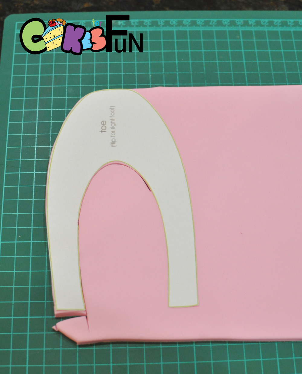 Now to do the top of the slipper. Follow steps above by rolling out your fondant, dusting your pattern and cutting out the first slipper top. Turn your pattern over and cut the top out for your other slipper.