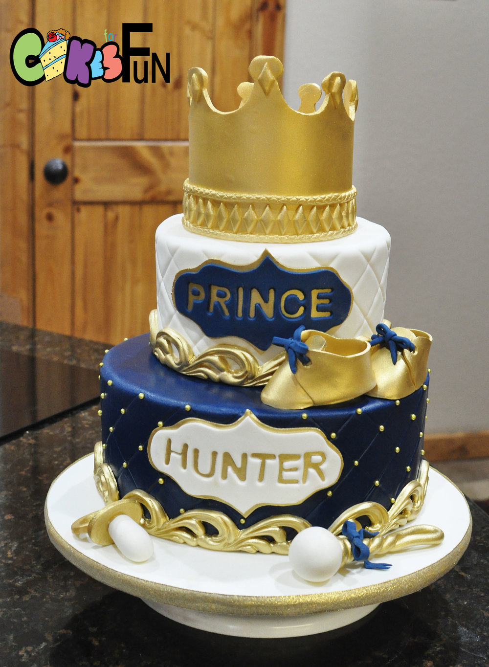 Gold and Navy prince cake.jpg