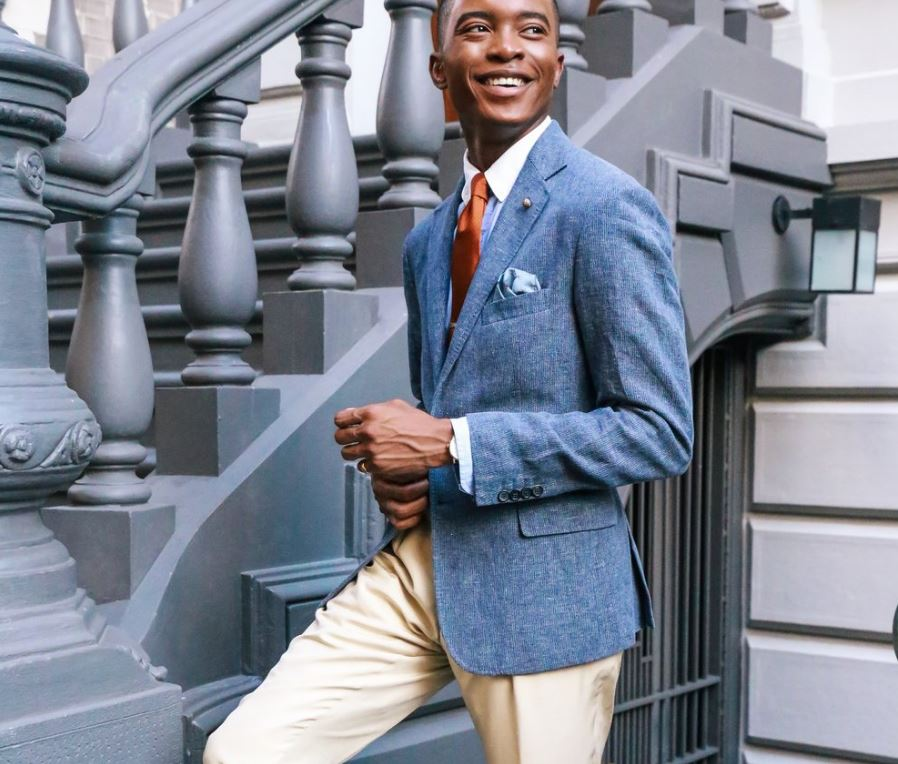 Photographed by, Xavier Duah. Heirloom Collection Trousers /  Billy Reid  . Lexington Jacket /  Billy Reid  . Red Wine Tassel Loafers /  Billy Reid  . Spiders Pocket Square /  Billy Reid  . Lapel Pin  /  Club Monaco  . Shirt /  Club Monaco  / Styling by Donnell Baldwin