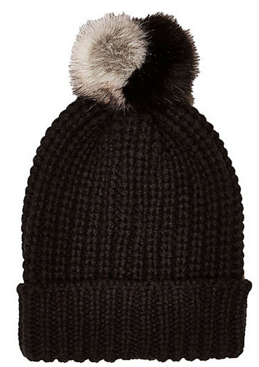 River Island Black Knitted Pom Pom Beanie Hat, $26 at US.RiverIsland.com.