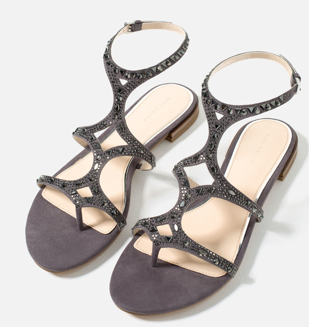 Zara Flat Sandals with Shiny Details, $49.90 at Zara.com.