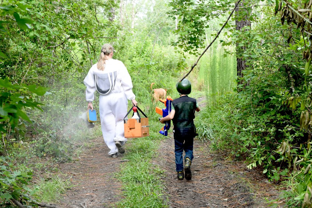 Photo provided by Tara Derr Darling  Rebeeca and 6 year old Steven heading to work in the beehives