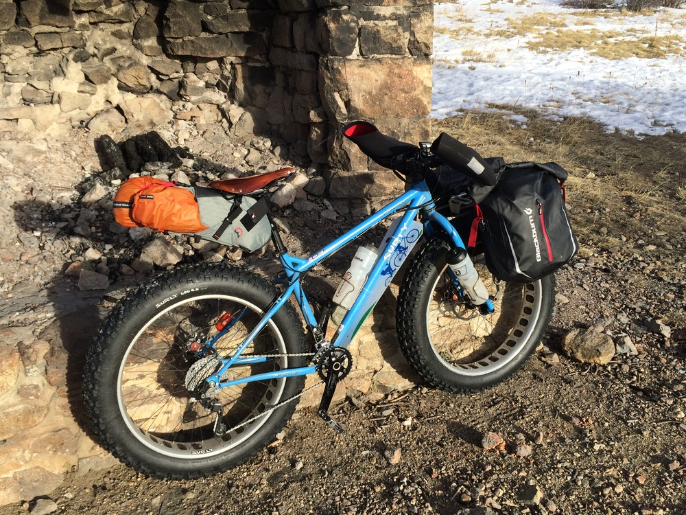 My trusty Surly Ice Cream Truck. For winter overnighters, it's my go-to bike, with a Blackburn front rack and panniers. A Revelate Terrapin easily holds my Big Agnes Copper Spur tent. Fenix BT20 on the bars, LD22 on the helmet, Cateye rear blinky. Bar Mitts to keep the digits happy. A Revelate Feed Bag for food, Fenix battery pack and Red Fox Bluetooth speaker. Also note the down tube fender fashioned from a stolen political yard sign (finally politics has a purpose!).