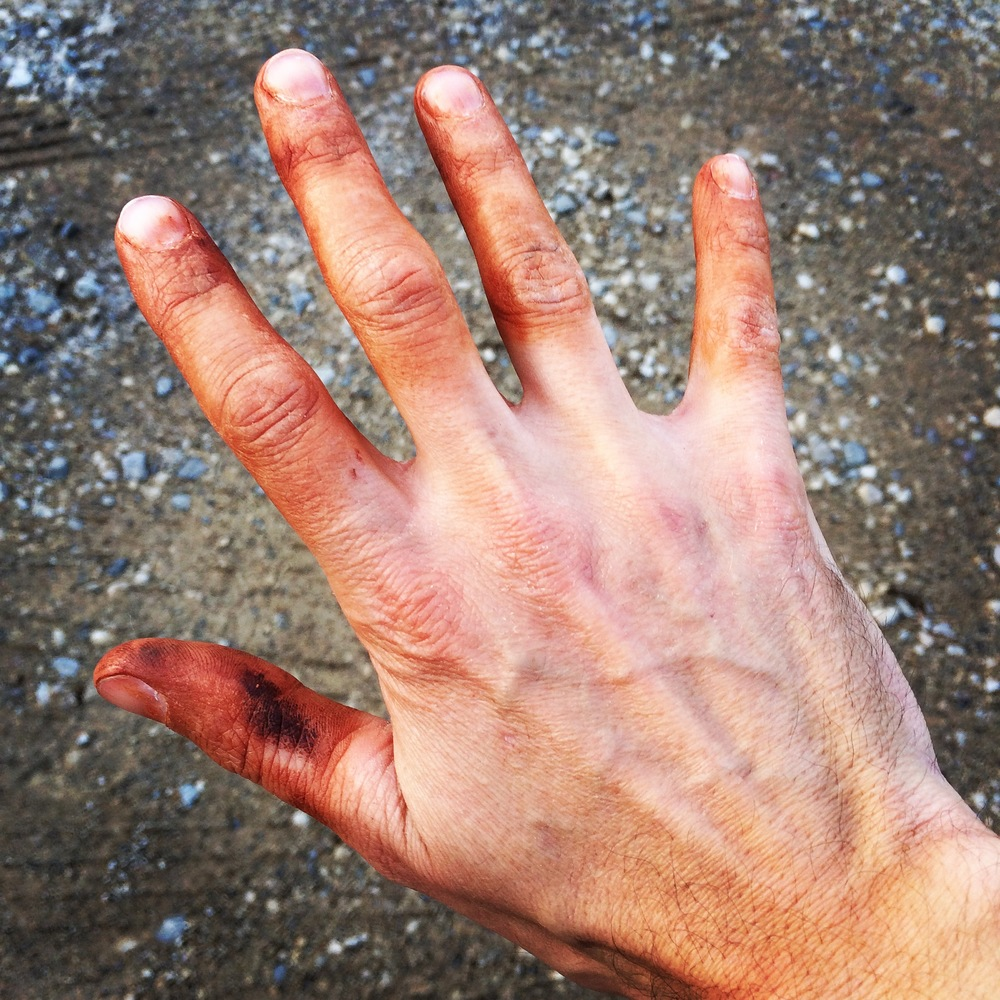 A red clay hand tattoo is the sign of a fun day of gravel and mud racing.