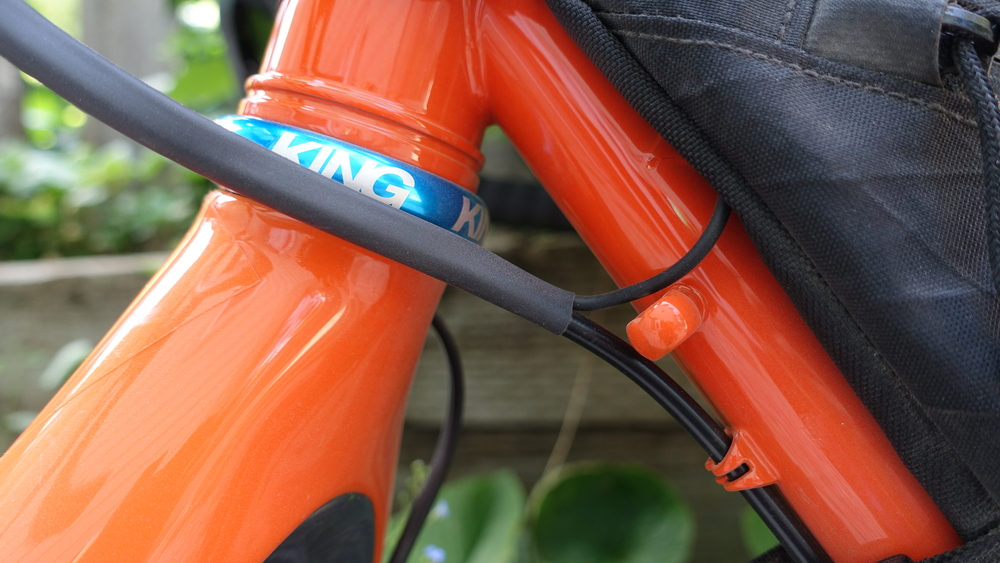 Shrink wrap is your friend, especially on Di2 bikes and even more so on bikepacking Di2 bikes. It keeps the wire out of the way and adds a layer to protect against a bag rubbing a hole in the wires.