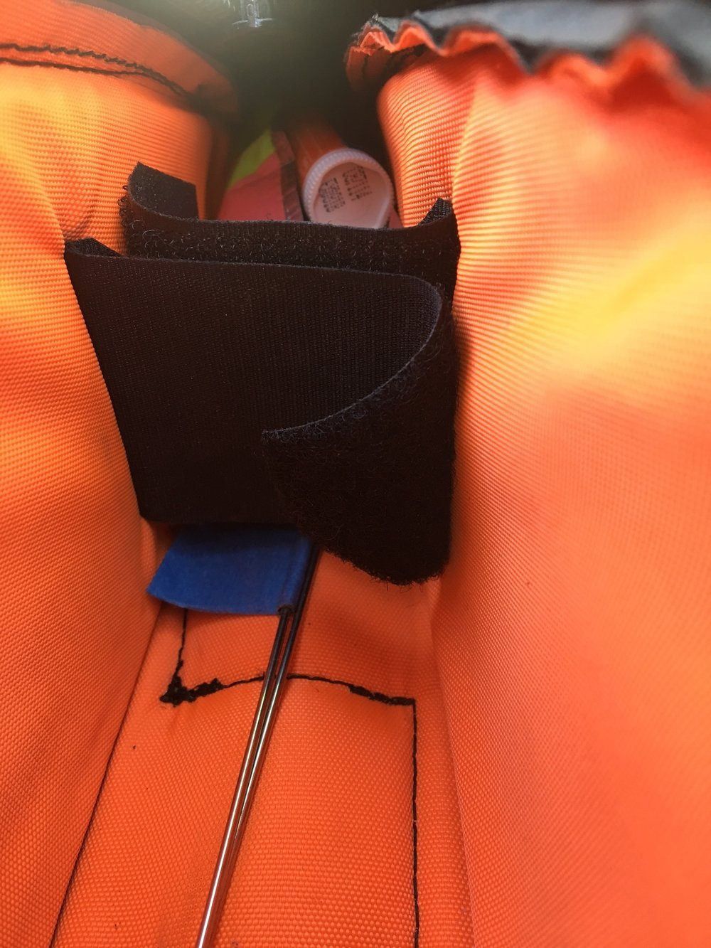 A divider keeps items from shifting around and allows me to widen or narrow the bag somewhat. As well as food, spare spokes are kept inside this bag.