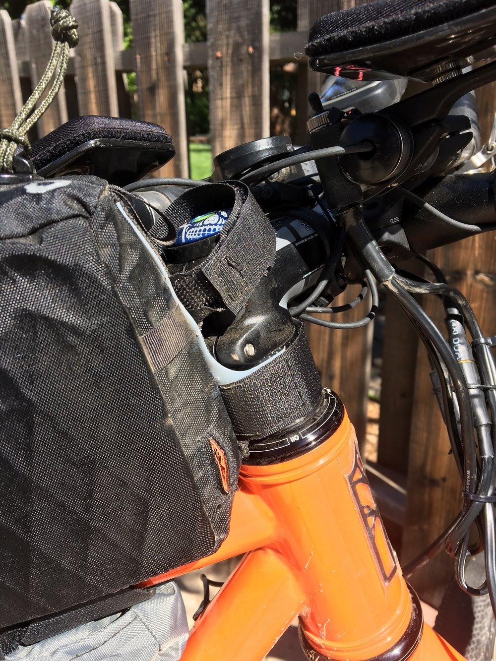 Dual front straps keep the tall bag nice and stable.