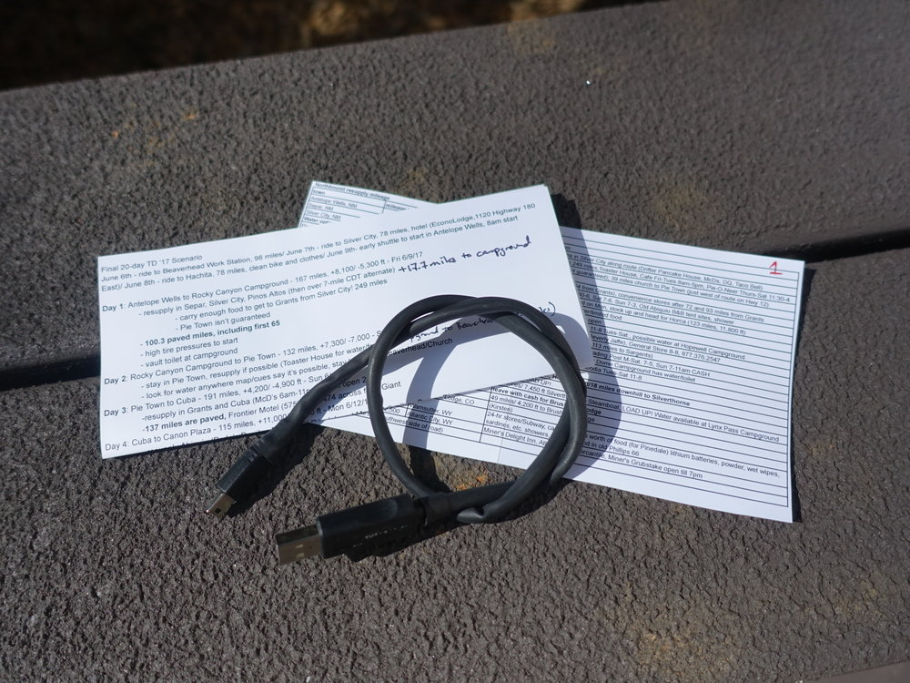 Info overload is entirely possible when prepping for 2,700 miles of self-supported racing. I put together 2 documents to help me with pacing and resupplies. The pacing notes may go straight into a trash can if weather throws me some big curve balls. But doing the research required to make them was extremely educational. I also carry all the cables necessary to reboot and upload to my Garmin GPS devices.