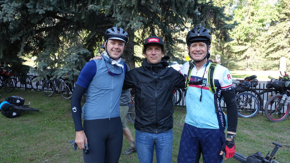 "Before they knew they'd be riding together for so many hours and so many miles.... a ""quick"" photo together in Banff"
