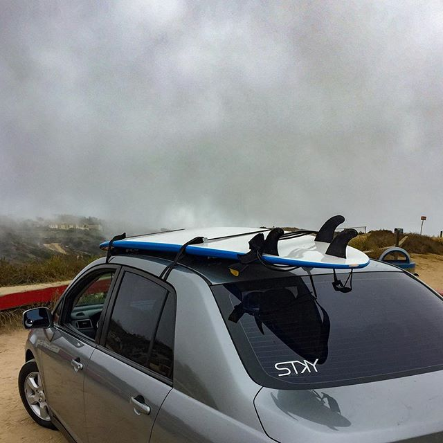 Surfer @David_albers15 not letting the weather prevent him from finding what sticks with him. Captured before a morning session at blacks beach. #stky #findwhatsticks #blacksbeach #surfing #sandeigo