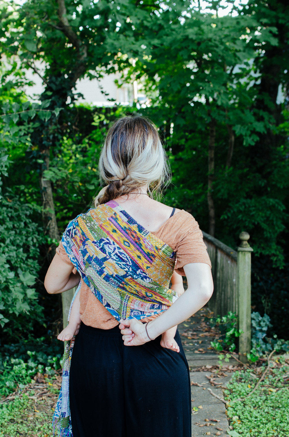 Make sure to fully spread the sling across your back for proper comfort and support.