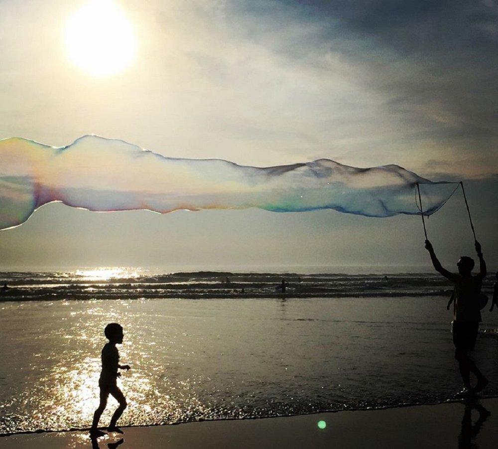 Sunset bubbles Perranporth beach.jpg