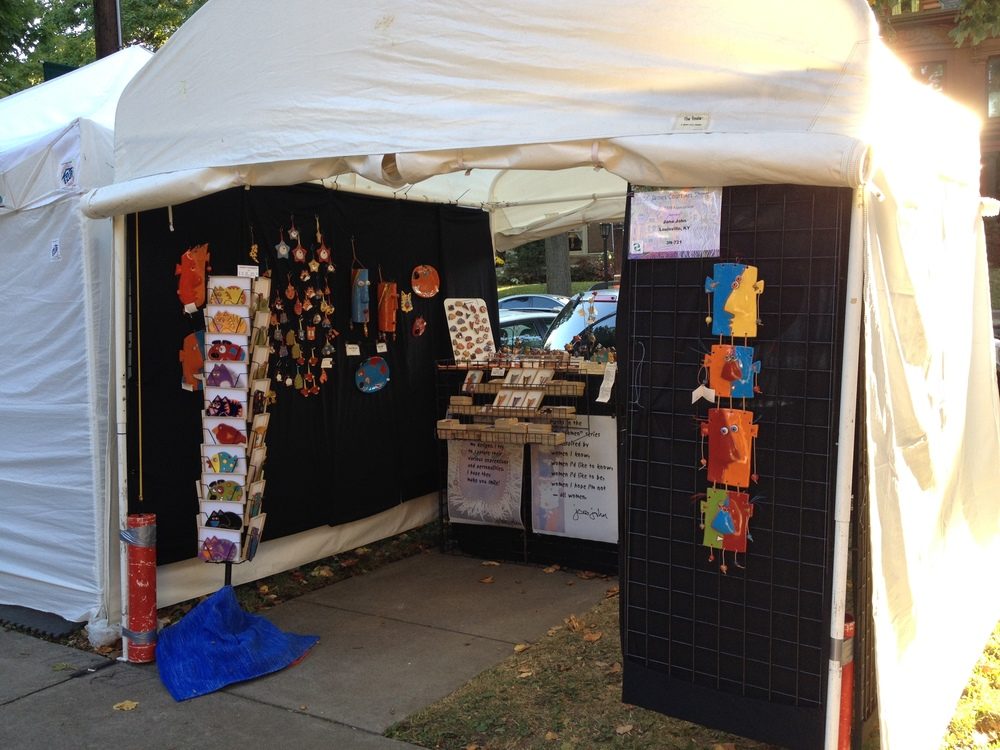 Showkitty Pottery's booth at the St. James Court Art Show in in the 1300 block of South Third Street.