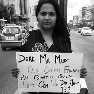 IDEX Alumni, Devina Singh, takes to the streets of Bangalore to question the Indian Prime Minister about saving the lives of thousands of cotton farmers. If you had one question for the Prime Minister, what would it be? #idexfellowship