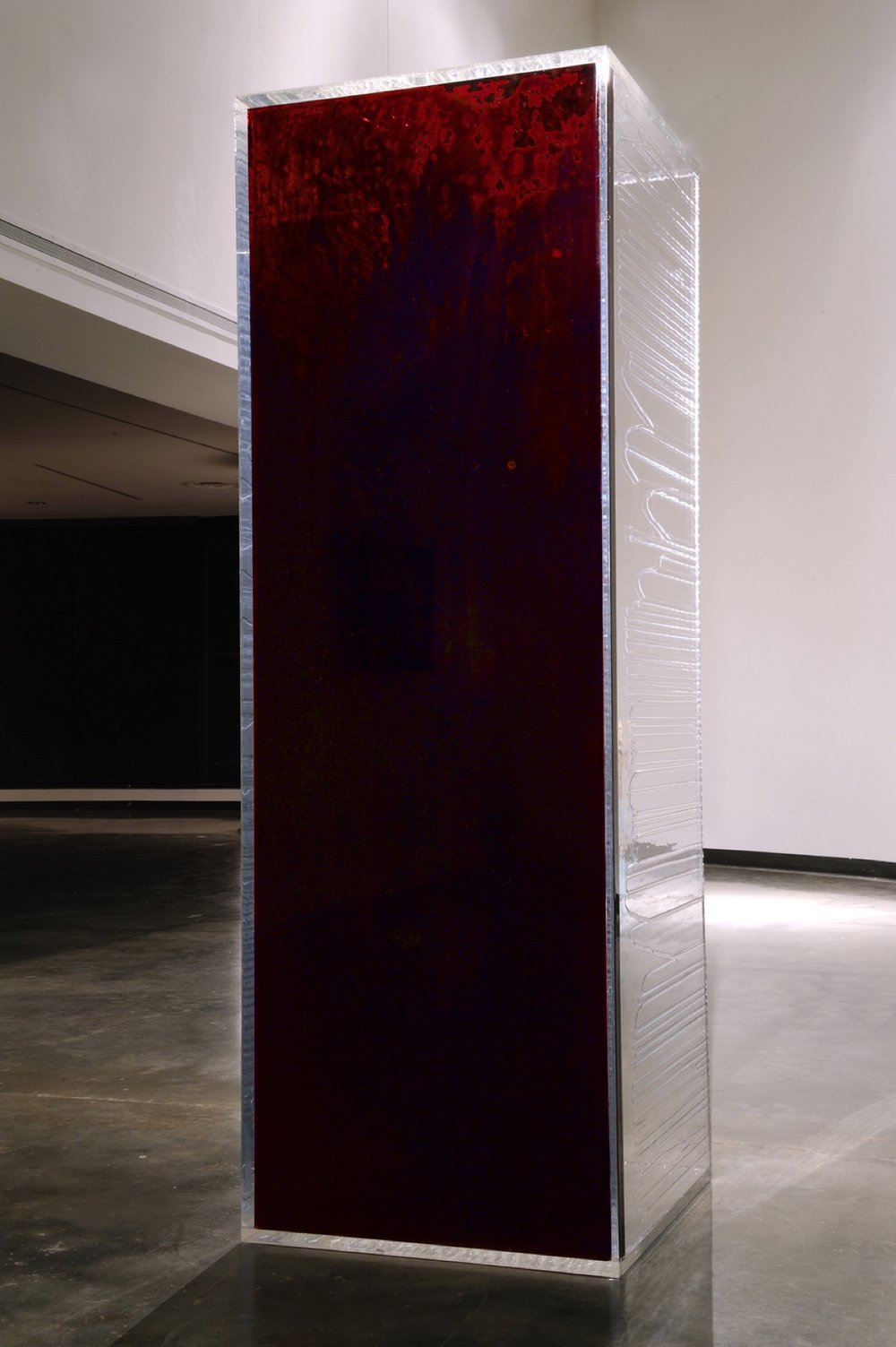 "Blood Mirror, 2015-present 84 x 28 x 28"" 59 human blood donations, blood of Oliver Anene, Blue Bayer, Howard Grossman, M.D., Kelsey Louie, Lawrence D. Mass, M.D., Reverend John Moody, Loren Rice, Ty Spicha, CPT Anthony Woods, 50 PrEP advocates, preserved in UV resin Medical Supervisor, Howard Grossman, M.D. Installation view, American University Museum at the Katzen Arts Center, Washington, DC, 2015"