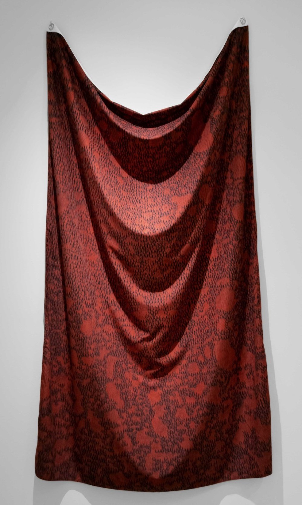 "Blood Flag, in collaboration with Jonny Cota of SKINGRAFT, 2015-present 84 x 53"" Sublimation print on fabric of red blood cells and thread stained in blood of Oliver Anene, Blue Bayer, Howard Grossman, M.D., Kelsey Louie, Lawrence D. Mass, M.D., Reverend John Moody, Loren Rice, Ty Spicha, CPT Anthony Woods, grommets, additional HIV testing blood samples from 27 individuals."