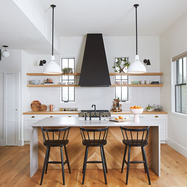 We love all the details that changed this kitchen from a finished project to a home.  Swipe left for the pre-move in pic. 📷 by @robert_gomez pendants by #schoolhouseliving and sconces by #cedarandmoss #kitchendesign #kitchens